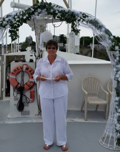 Rev Sharon Under Wedding Arch on Boat at Fisherman's Wharf in Lewes, DE