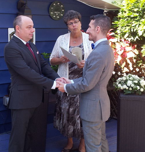 Another happy gay couple married outdoors at the Bewitched and BEdazzled Bed and Breakfast in Rehoboth, Delaware