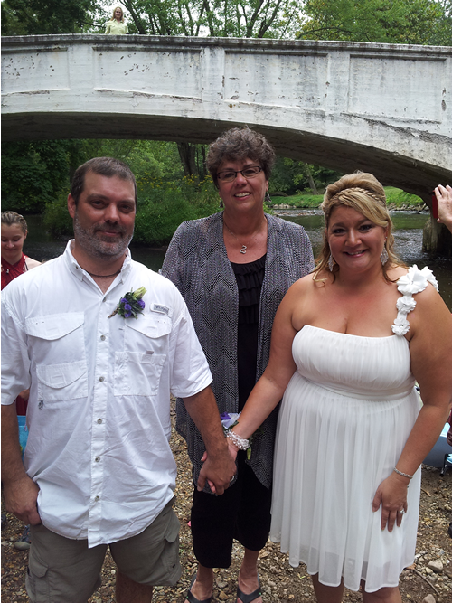 Happy couple had a kayak wedding with Rev Sharon